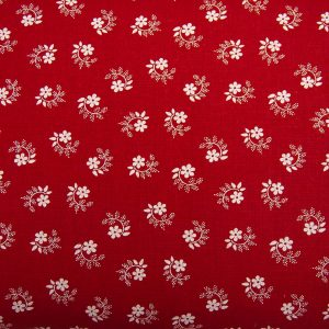 Kwiatuszek pętelka na czerwonym - tkanina bawełniana