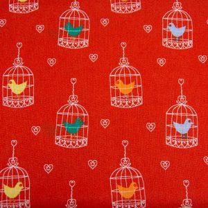Ptaszki w klatkach na ceglastym - tkanina bawełniana