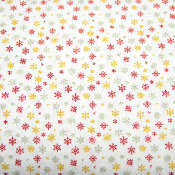 Bordo i żółte śnieżynki na bieli - tkanina bawełniana