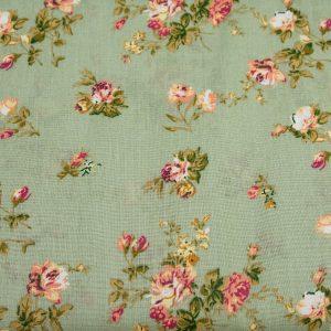 Róże na pistacjowym - tkanina bawełniana