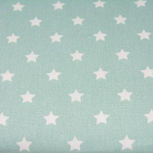 Gwiazdy na miętowym - tkanina bawełniana