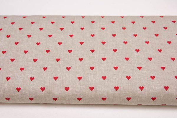 Czerwone serduszka na beżu - tkanina bawełniana