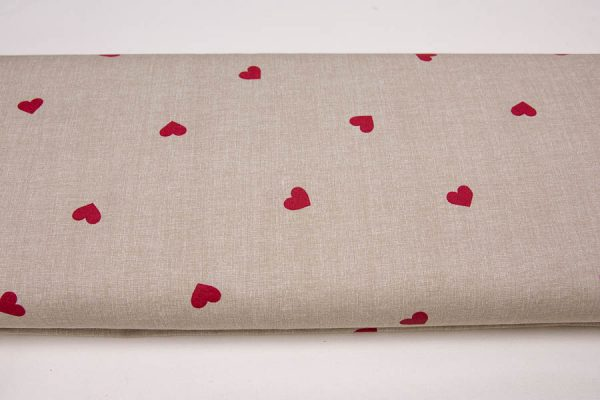 Czerwone serca na beżu - tkanina bawełniana