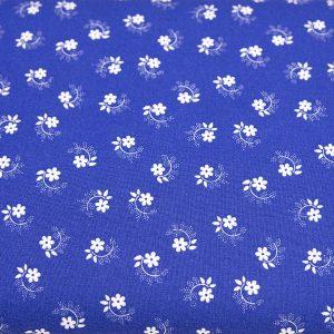 Kwiatuszek pętelka biały na szafirowym - tkanina bawełniana