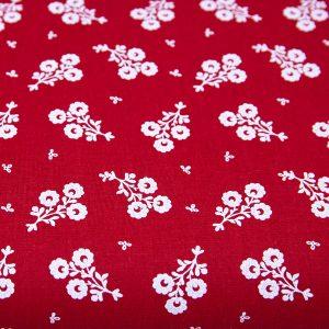 Białe bukieciki na czerwieni - tkanina bawełniana