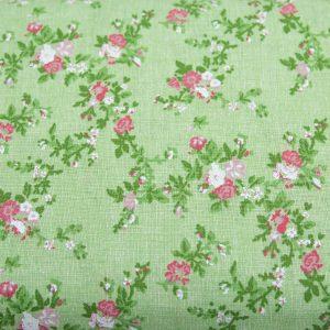 Gałązki kwiatów na pistacjowym - tkanina bawełniana