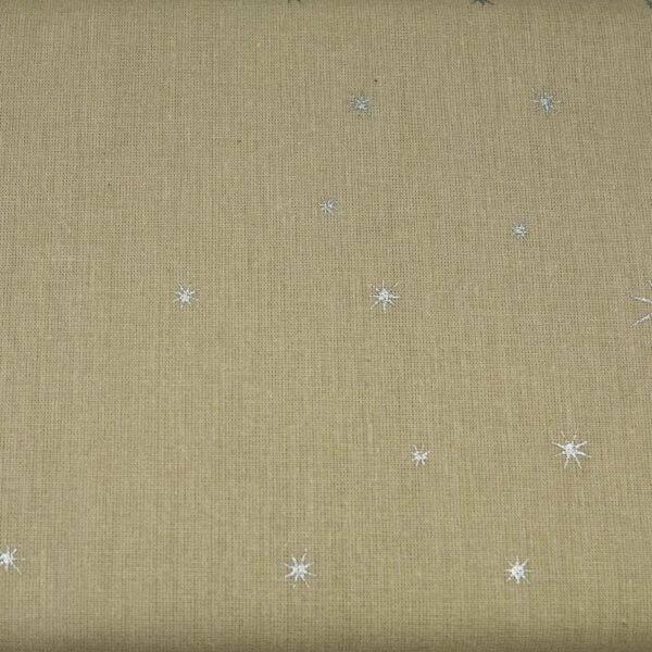 Srebrne gwiazdki na beżu - tkanina bawełniana