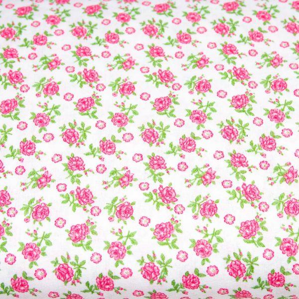 Różowe różyczki na bieli - tkanina bawełniana