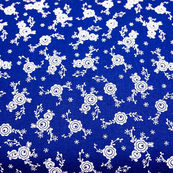 Białe pawie oczka na ciemnoniebieskim - tkanina bawełniana